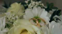 Marriage wedding , rings on bouquet 002 Stock Footage