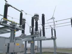 Green power supplies to network. Windmill near power transformer Stock Footage