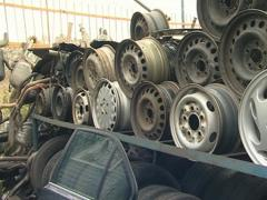 Automobile parts in dump. Wheels and other used parts. Stock Footage