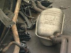Fragment of exhaust, tie rod and the other used automobile parts Stock Footage