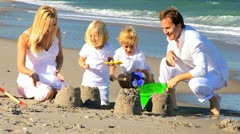 Happy Young Family Enjoying Beach Vacation Stock Footage