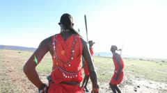 Maasai warriors jumping together on open savannah, Maasai Mara. Kenya, Africa. Stock Footage