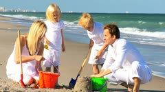 Happy Children and Parents Playing in the Sand Stock Footage