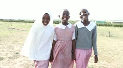 Three school girls walking together. Kenya, Africa. Stock Footage