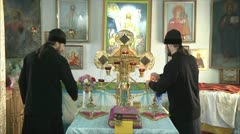 Priests lit candles Stock Footage