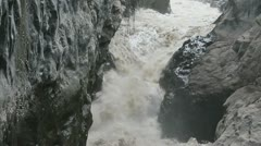 Muddy stream rushing trough Volcanic rocks on Mt, Tungurahua Ecuador Observe the Stock Footage
