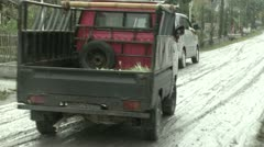 Vehicles Skid Along Volcanic Ash Coated Street In Indonesia - stock footage
