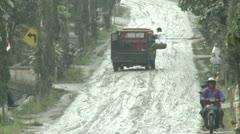 Vehicles Skid Along Volcanic Ash Coated Street In Indonesia Stock Footage