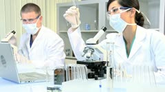 Medical Technicians Studying Research Data Stock Footage