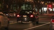Stock Video Footage of A police car drives on a downtown Los Angeles street at night.