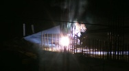Stock Video Footage of The work of the welder on the night construction