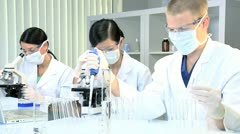 Three Medical Researchers in Laboratory - stock footage