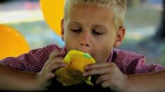 Blonde Boy Eats Yellow Cupcake - Gets Over Face Stock Footage