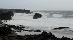 Rough seas, crashing waves on the stormy Icelandic coast Stock Footage