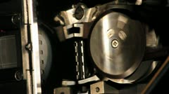 35mm Film in Movie Camera (Slow Motion) - stock footage