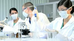 Research Assistants Working in Medical Laboratory - stock footage