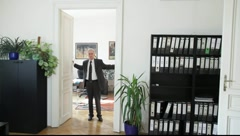 A business man opens the door and looks inviting Stock Footage