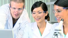 Doctor and Research Students in Laboratory - stock footage