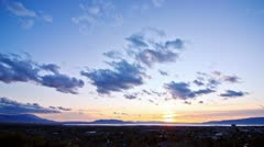 Sunset over City, Mountains, and Lake - stock footage