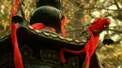 Dragon and metal bell on censer tower,Red ribbon blowing in wind,Trees,shade. Stock Footage