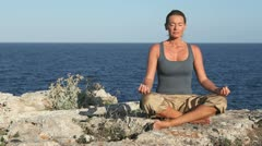 Meditation at sea on a cliff Stock Footage
