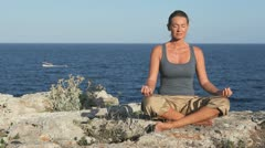 Meditation at sea on a rock Stock Footage
