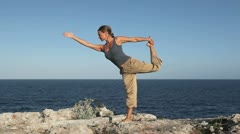 Yoga excercise at sea Stock Footage