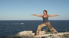 Yoga Asana on a cliff Stock Footage