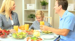 Young Family Eating Healthy Meal - stock footage