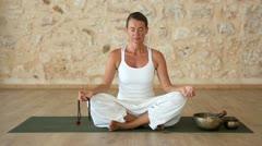 Woman meditating indoors - stock footage