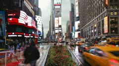 42nd street in the rain Times Square, Manhattan, New York, USA, T/lapse  - stock footage