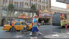 Walk of Fame stars on Hollywood Boulevard and El Capitan Theatre in Los Angeles Stock Footage