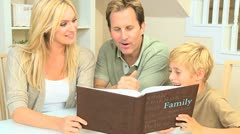 Young Caucasian Family with Photograph Album - stock footage