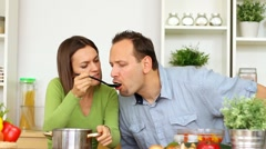 Young couple tasting bad taste food in the kitchen HD Stock Footage