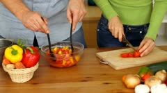 Man and woman hands preparing salad on the table HD Stock Footage