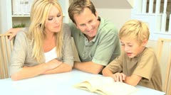 Proud Parents Listening to Their Son Reading - stock footage