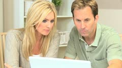 Young Couple Seeking Financial Solutions - stock footage