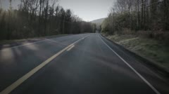 Driving down Windy Road at high speed Stock Footage
