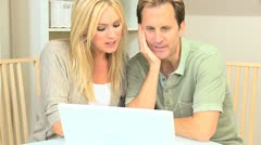 Attractive Couple Happy with Their Financial Planning Stock Footage
