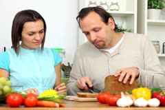 Young happy couple preparing breakfast in kitchen NTSC Stock Footage