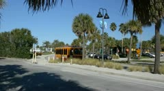 Trolley bus passes by Clearwater beach Stock Footage