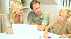 Young Blonde Boy with Parents Using Color Pens - stock footage