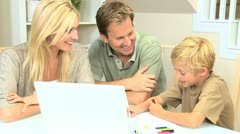 Parents Watching Son with Laptop and Color Pens - stock footage