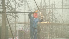 Chinese Workers Welding Lanterns - stock footage