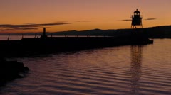 Grand Marais Lighthouse At Sunset Stock Footage