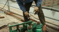 Chinese Worker Repairing A Grinder Stock Footage
