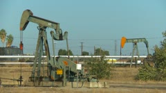 Oil & Gas, oil pump-jacks in urban area, early morning, southern California Stock Footage