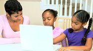 Ethnic Mother Watching Daughters Using Laptop Stock Footage
