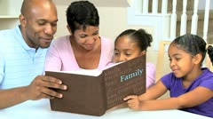 Young Ethnic Family with Photograph Album - stock footage