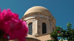 Pink flowers on the background of the Greek church Stock Footage